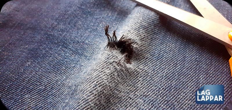 Jeans med trasigt hål