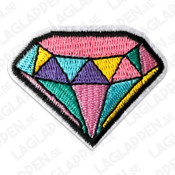 tygmärke färgglad diamant