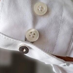 Extraknappar för skjortans arm om skjortarmen är för smal