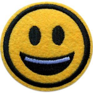 Leende emoji visar tänder | tygmärke