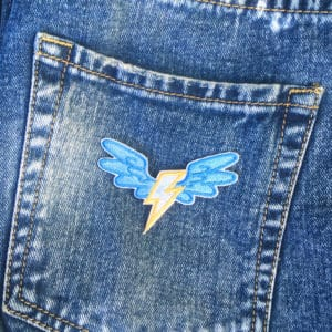 Blixt vingar jeans - tygmärke