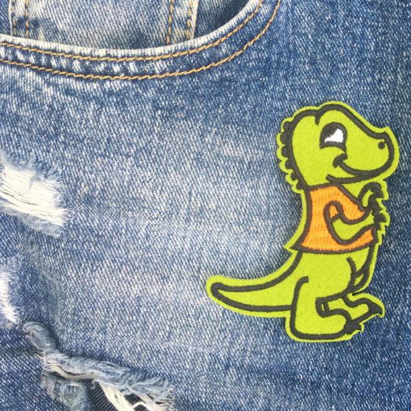 cool krokodil orange väst jeans - tygmärke