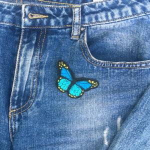 Fjäril blå gul jeans - tygmärke
