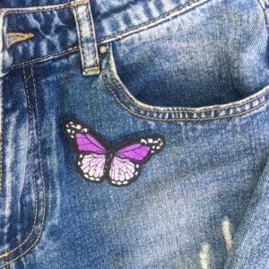 Fjäril lila jeans - tygmärke