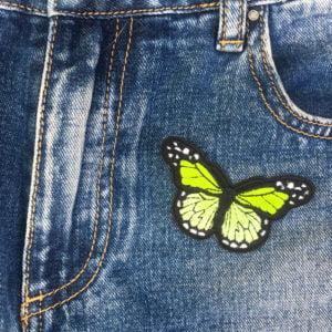 Fjäril limegrön jeans - tygmärke