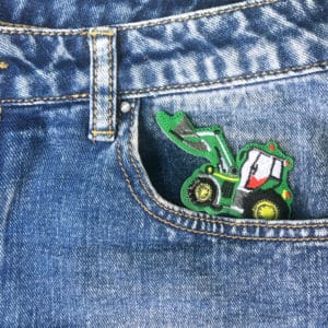 Grävskopa grön jeans - tygmärke