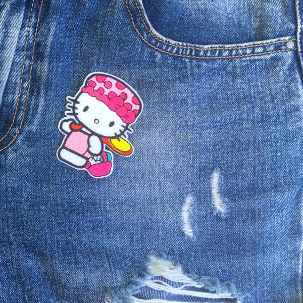 Hello Kitty Badmössa jeans - tygmärke