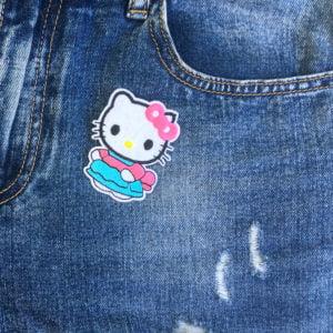 Hello Kitty blå dräkt jeans - tygmärke