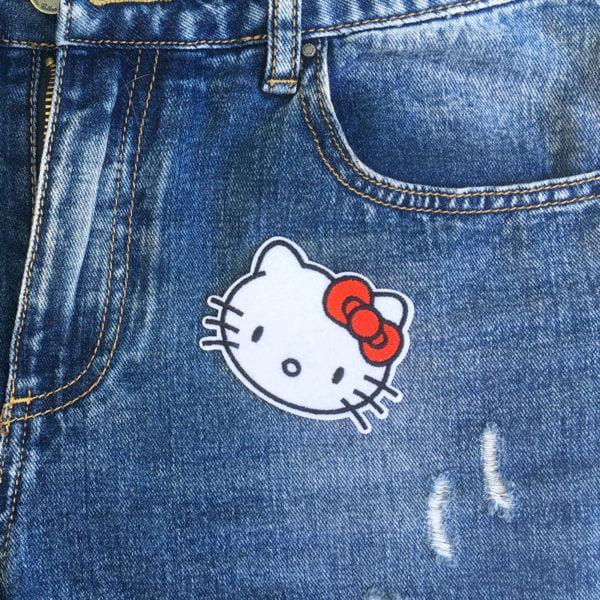 Hello Kitty huvud jeans - tygmärke