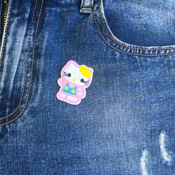 Hello Kitty rosa kant jeans - tygmärke