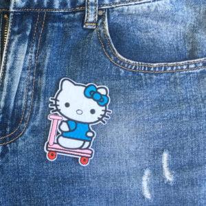 Hello Kitty skooter jeans - tygmärke