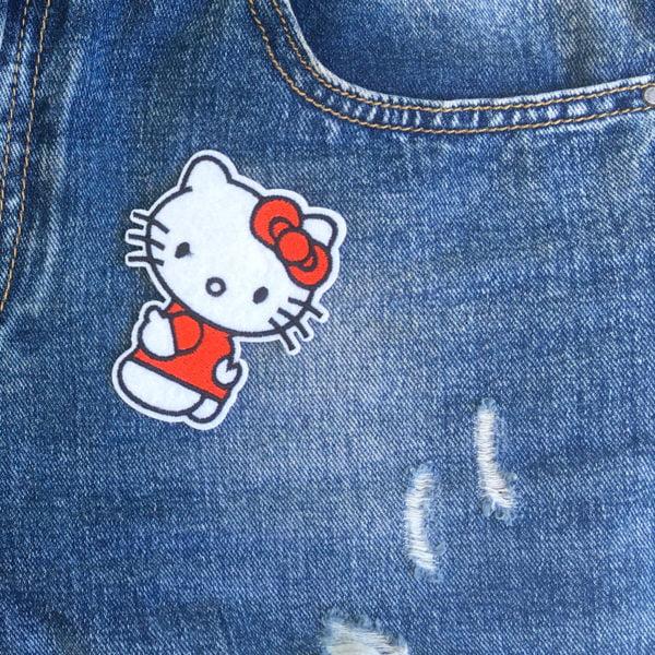 Hello Kitty tummen upp jeans - tygmärke