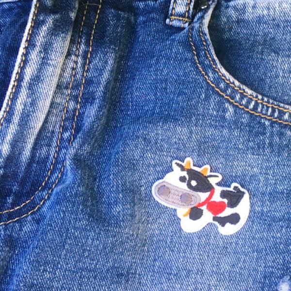 kossan mu jeans - tygmärke