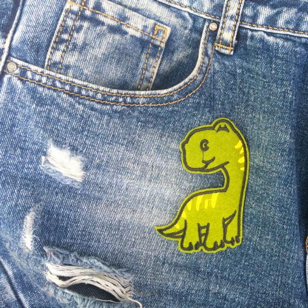 lång dino gula streck jeans - tygmärke