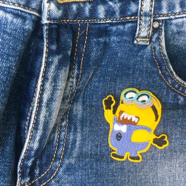 Minions se upp jeans - tygmärke