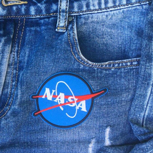 NASA symbol jeans - tygmärke