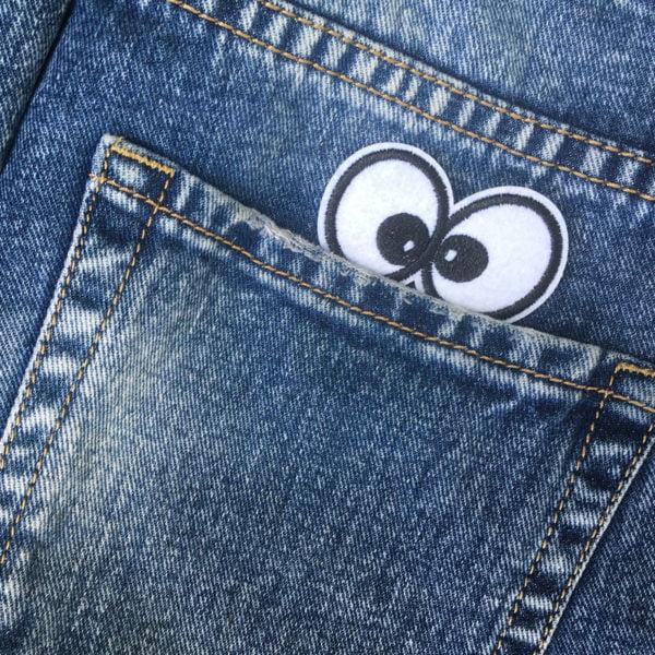 Nyfikna ögon jeans - tygmärke