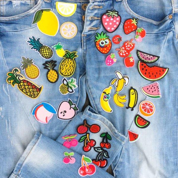 Flera tygmärken för barn föreställande citroner, meloner, bananer och jordgubbar