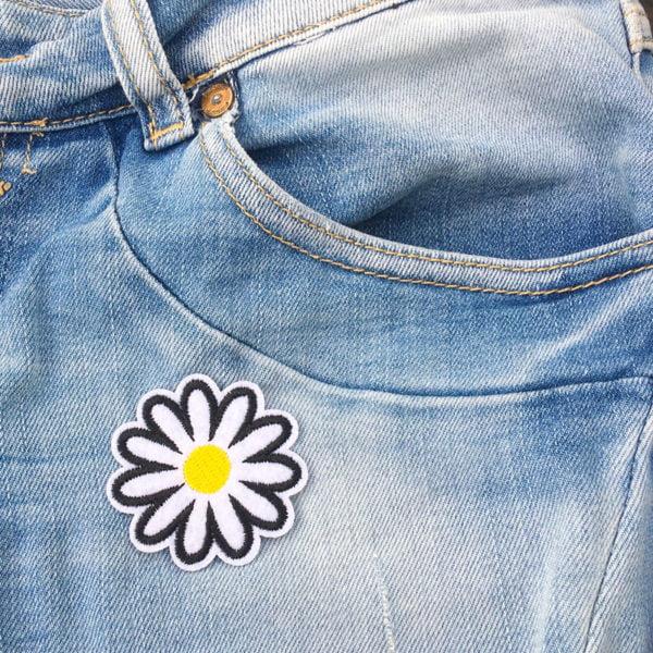 Prästkrage på jeans - tygmärke