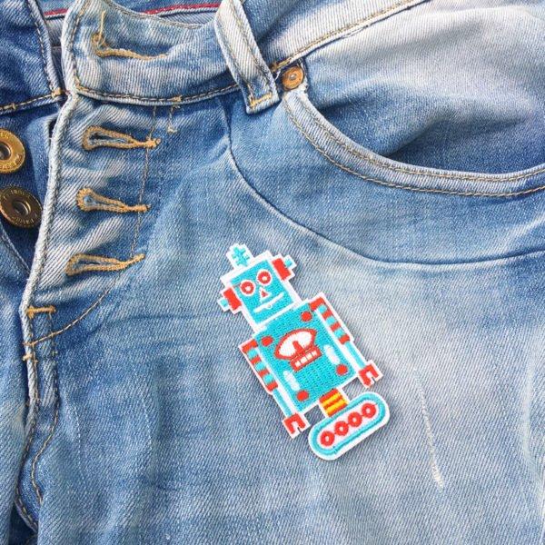 Turkos robot på jeans - tygmärke