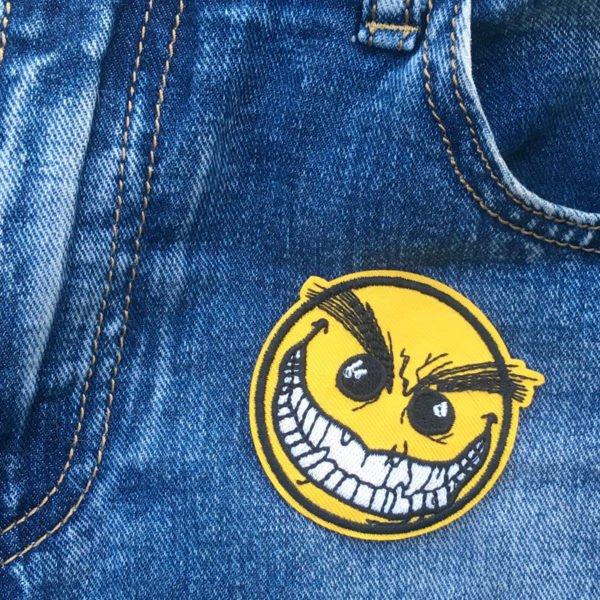 smiley crazy leende jeans - tygmärke