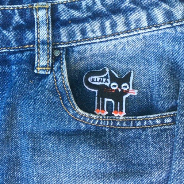 Svart katt orange tassar jeans - tygmärke