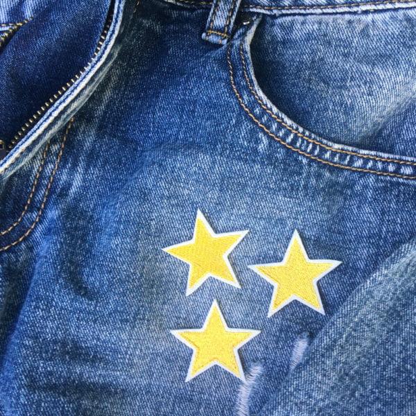 tre stjärnor guld jeans - tygmärke
