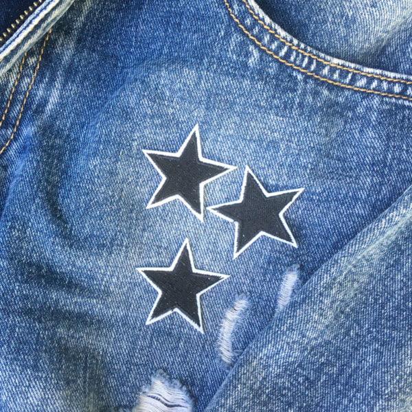 tre stjärnor svart jeans - tygmärke