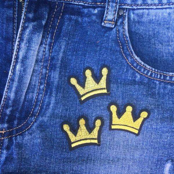 Trekronor guld jeans - tygmärke