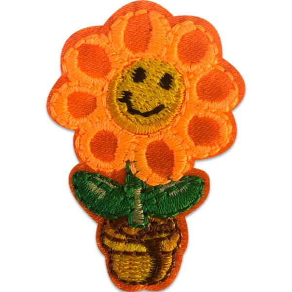 Orange blomma i kruka - Tygmärke