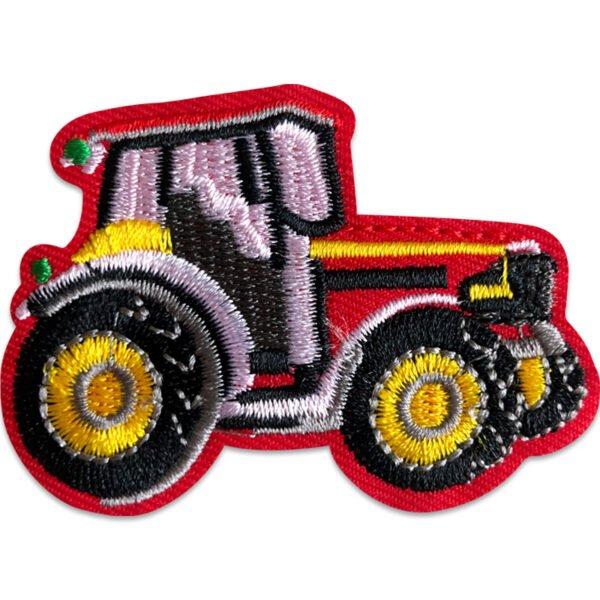 tygmärke rosa traktor