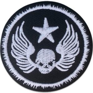 dödskalle vingar stjärna - tygmärke