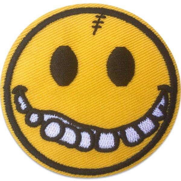 Tygmärke Smiley - Behov av tandställning