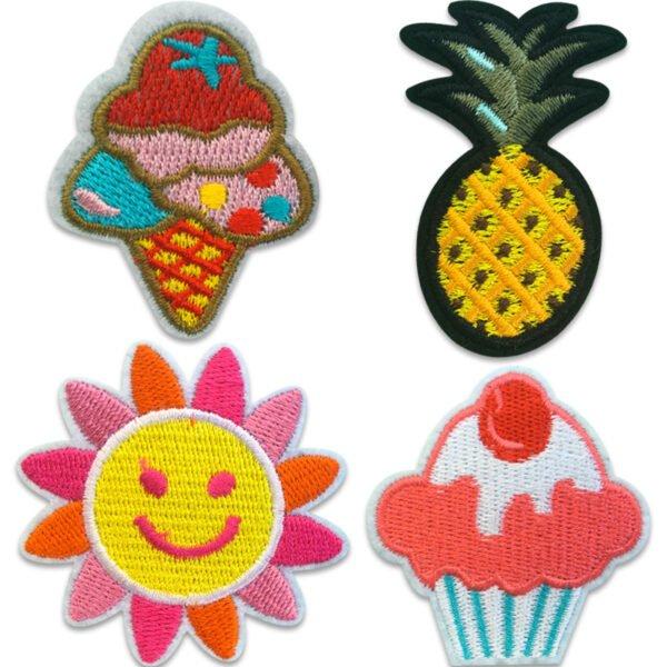 Tygmärken föreställande en glass, en ananas, en färgglad sol och en muffins