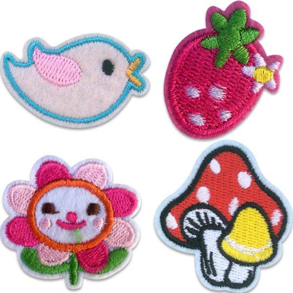 Tygmärke jordgubbe, fågel, blomma och en svamp
