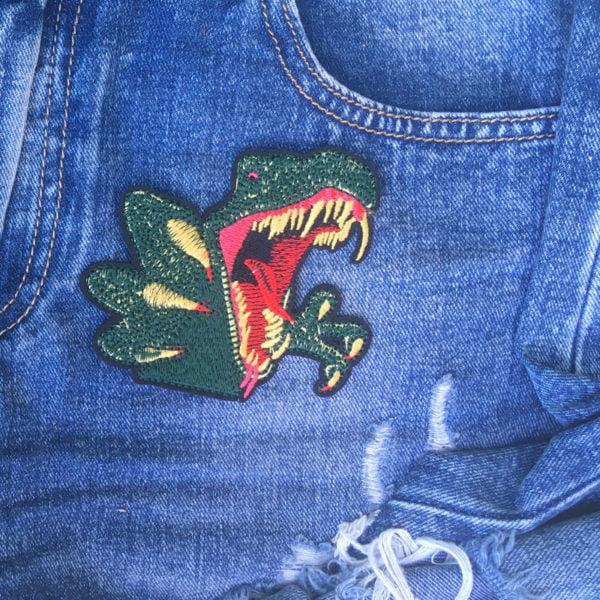 Tyrannosaurus Rex Monster jeans - Tygmärke