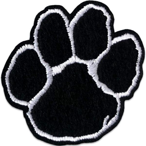 Tygmärke föreställande svart hundtass