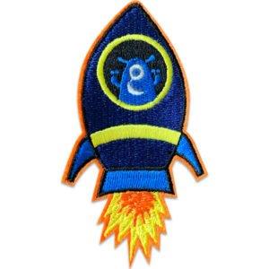 blå rymdvarelse i raket - tygmärke