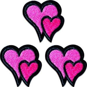 tygmärke -tre små dubbelhjärtan