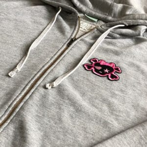 rosa dödskalle rosett tröja - tygmärke