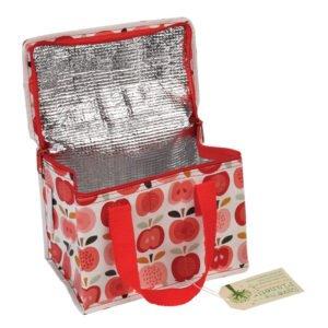 öppen lunchväska med motiv på äpplen
