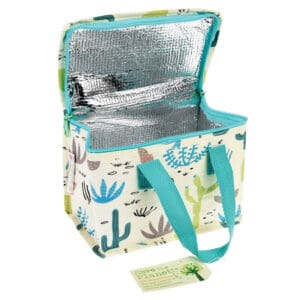 öppen lunchväska med motiv på kaktusar