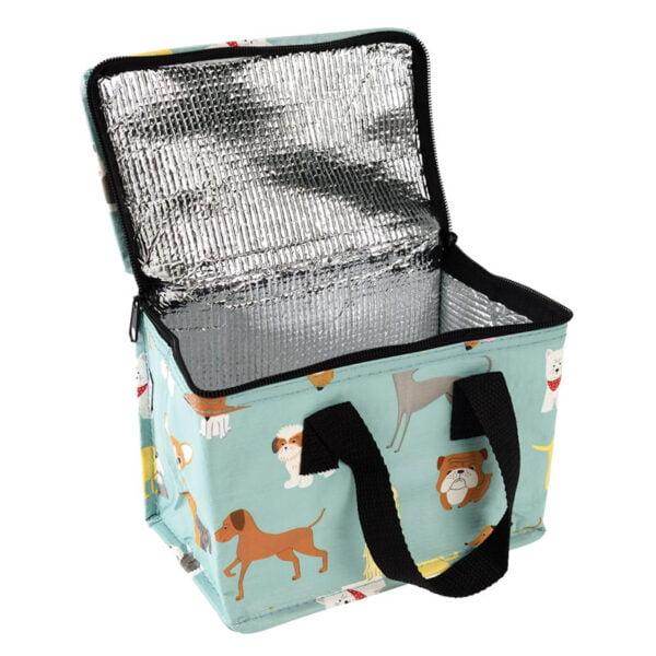 öppen lunchväska med motiv på hundar
