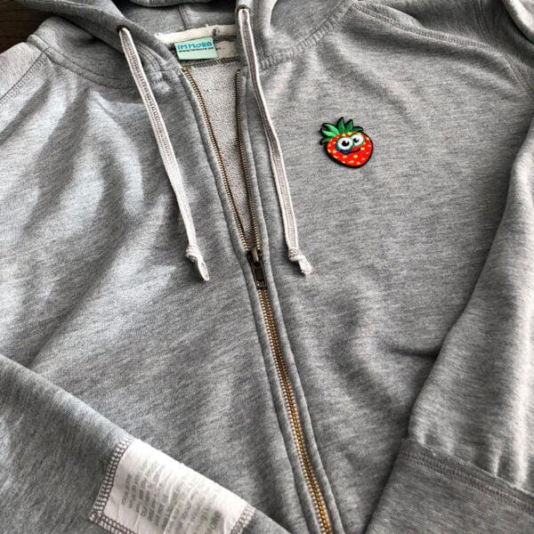 rolig jordgubbe tröja tygmärke