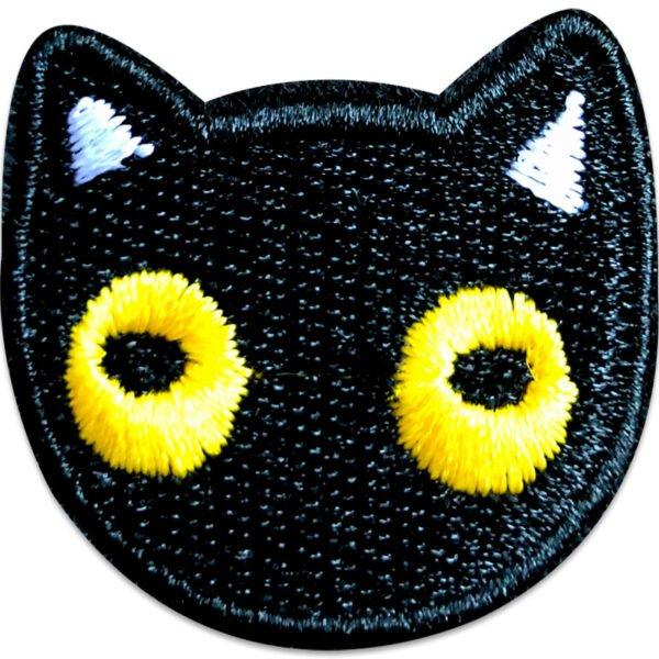 Tygmärke gullig katt gula ögon