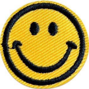 liten smiley tygmärke