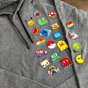 pixel tygmärken tröja