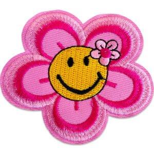 Rosa blomma smiley som är glad
