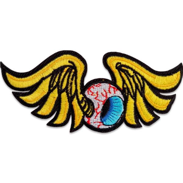 öga med vingar tygmärke