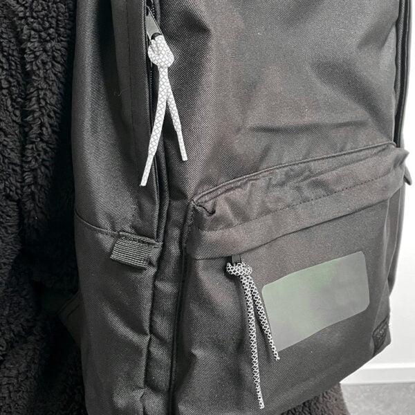 reflexsnören på ryggsäck